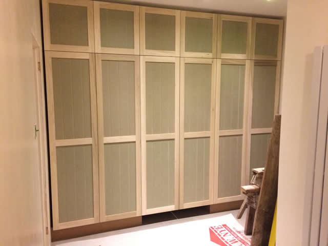 Bespoke cupboard installed with pull out desk in Brockham 2