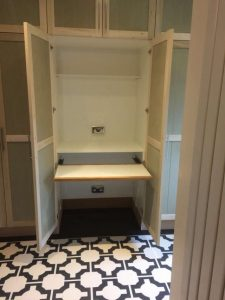 Bespoke cupboard installed with pull out desk in Brockham 5