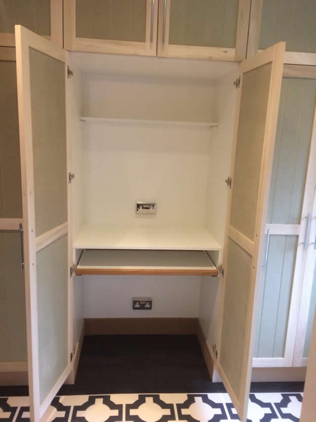 Bespoke cupboard installed with pull out desk in Brockham 6