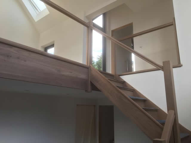 Walnut staircase with glass balastrade 10