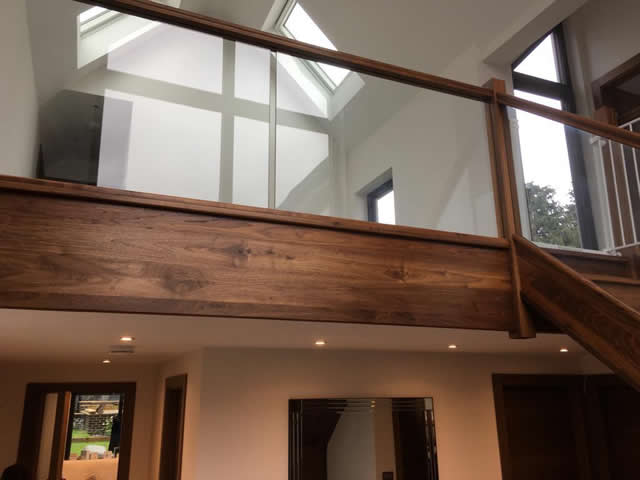 Walnut staircase with glass balastrade 13