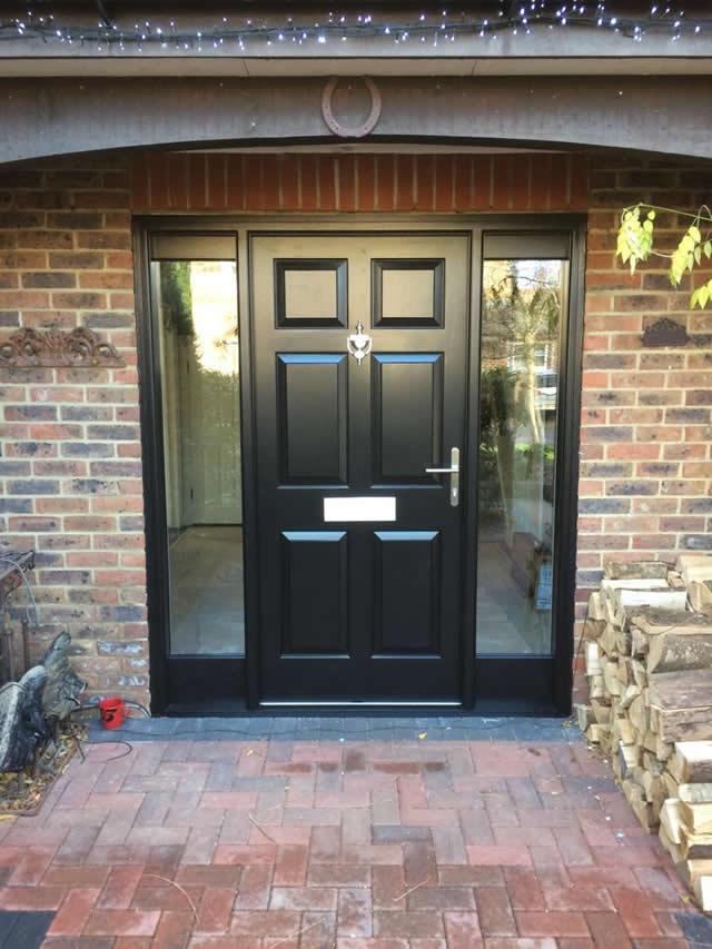 Entrance door with side lights finished in Black satin - After