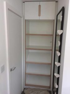 Shelving unit with cupboard above almost complete