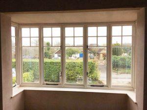 Hardwood bay windows installed with a single sash window